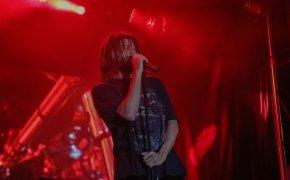 J Cole on stage