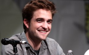 Robert Pattinson sitting