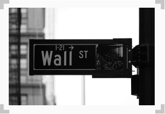 photo of street sign that says 'wall street'