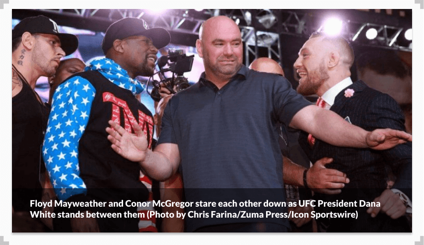 Floyd Mayweather and Conor McGregor stare each other down as UFC President Dana White stands between them