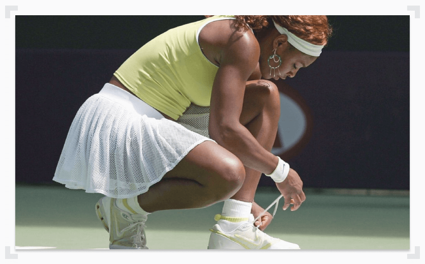 Serena Williams socks and tying shoes