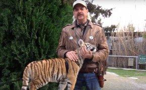 Joe Exotic posing with a tiger