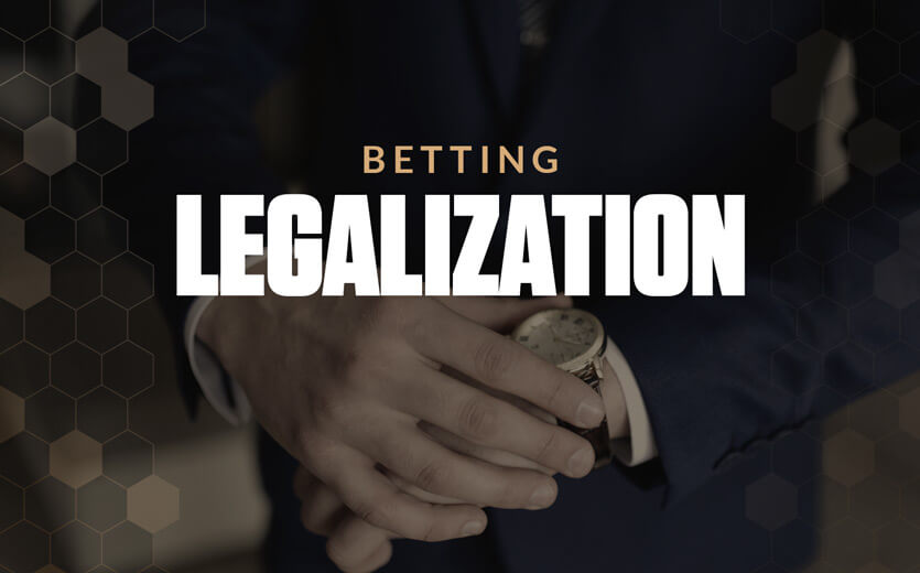 betting legalization text overlay on man looking at watch